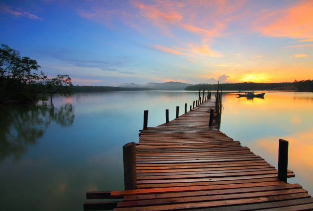 A Natural Sunrise over a Wooden Dock in the Heart of Ontario's Lake Region