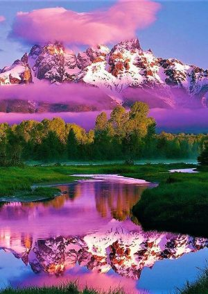 Purple Clouds Passing By Some Natural Rugged Mountains in the Untouched Wilderness