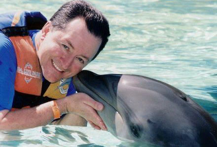 Marvin Getting Kissed by a Dolphin in the Water